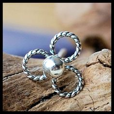 ONE of a KIND - Silver Nose Stud Twisted Flower. $39.95, via Etsy.