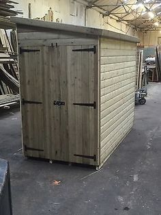 """8 x 4 fully tanalised motorcycle shed 3x2 cls 22mm loglap 1"""" thick floor."""