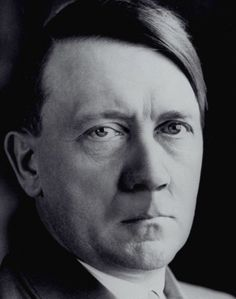 It's astonishing how much difference facial hair can make in the appearance of a man, even a toothbrush mustache like Hitler liked to sport. Here's Der Fuehrer without his trademark bristle-stripe. What's remarkable is how unremarkable he looks. He seems like he might be more comfortable as the headmaster of a small private school.