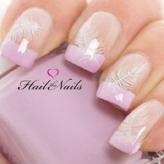 Pink and white feather nail art French tip. There is so much more that you can do with French tips and this feather nail art proves so. Add white feather details on top of your pink French tips and finish off with a shiny clear coat.