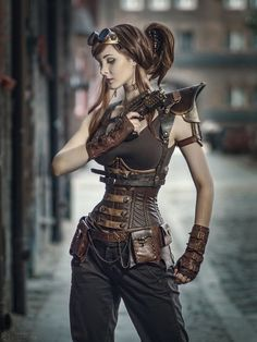 Brown steampunk outfit including faux leather corset and gloves with buckle details.. DIY the look yourself: http://mjtrends.com/pins.php?name=brown-faux-leather-for-steampunk