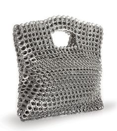 This bag has been created for sale in the Escama Studio online shop. The company is creating very innovative and unique products by crocheting pull tabs from drinks cans. Not only are they recycling thousands of the pull tabs but they are creating a beautiful, almost chain-mail fabric, taking the idea of crochet to whole new level! (Imagine how heavy these products are!!)