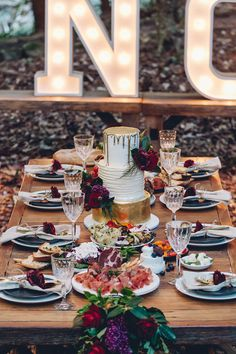 Modern feasting style wedding reception with jewel toned flowers | Kristie Carrick Photography