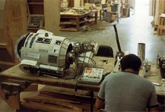 R2D2 needs a fix by the Art Department at Star Wars (George Lucas, 1977)