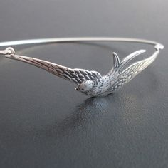 Silver Sparrow Bracelet Sparrow Bangle Bird Charm by FrostedWillow, $27.95   Bridesmaid gifts?