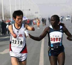 A Kenyan elite runner passes water to a dehydrated disabled Chinese runner who was suffering. Make Seva a #Habit. #help #life www.narayanseva.org