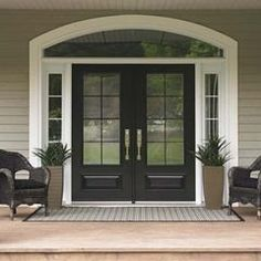 Black front door. White trim.