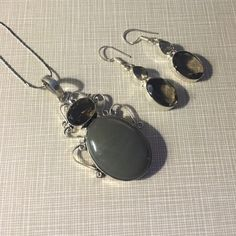 Pretty smoky quartz and grey Onyx pendant Pendant is 2.2 long is sterling overlay and comes with a 925 stamped silver chain 18' handcrafted FREE earrings approximately 1'3/4 long matching stamped 925 NWOT artisan unique set Jewelry Necklaces