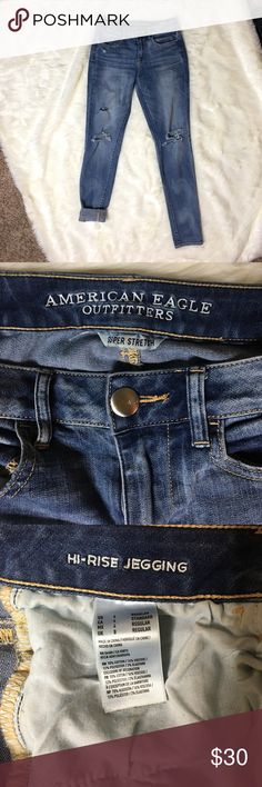 Jeans Sooo comfortable. High-rise, medium blue, distressed jeans. There is a slightly discolored spot on one of the back pockets. American Eagle Outfitters Jeans Skinny