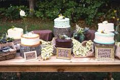 Really want a cheese and biscuits table with wedding cake on it. A salad table, a picnic table and a cake table that looks like this!