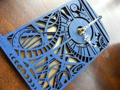 The Wibbly Wobbly Timey Wimey Tardis Clock. Cut out of birch wood and painted blue with a metallic gold backing, and absolutely no numbers because what fun would that be?