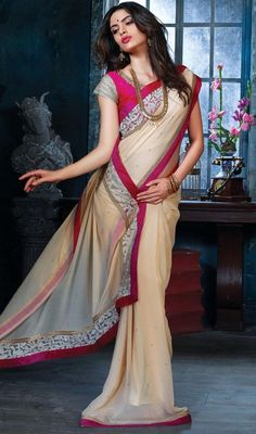 Attain a desirable value and dainty style with this beige color bamberg sari. The ethnic butta and zari work for the attire adds a sign of splendor statement with your look. Upon request we can make round front/back neck and short 6 inches sleeves regular saree blouse also. #AttractiveBeigeBambergSaree