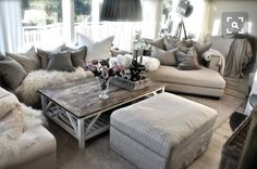 What do you get when you put shiplap, reclaimed wood, pastel flowers, and chandeliers together? Rustic glam. At one point I thought I loved all things rustic farmhouse until I met rustic glam. It is my spirit animal. There is something about a soft gray room with natural wood elements mixed with sil