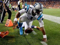 Carolina Panthers quarterback Cam Newton (1) falls out of bounds after scoring a…
