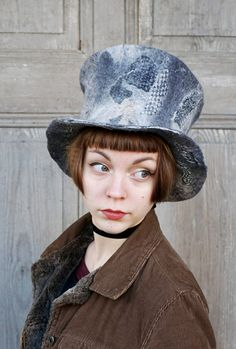 Magic wizards top hat, high hat , fancy felted hat, one of a kind, in shades of gray, nuno felted with vintage silk fabric. I made it of Australian merino wool using only hot water and natural soap. Decorated with silk fabric and bamboo fibers. Unique hat to men or women. Light and elegant. Mad Hatters hat. Excellent addition to the steampunk, victorian or goth creations!  Head circumference - ca 56 -58 cm (22 - 23 inches) height - ca 16 cm ( 6,3 inches )