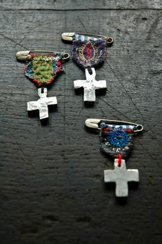 Silver crosses with embroidered badges