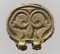 Gold Belt Mount (Miscast and Unfinished) Date: 700s Culture: Avar Medium: Gold, cast. Dimensions: 1 9/16 × 1 7/16 × 3/8 in., 1.35 Troy Ounces (3.9 × 3.6 × 0.9 cm, 42g)