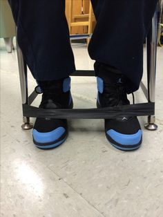 Fidget fixer : for students who are constantly out of their chairs, swinging their legs, or sitting incorrectly in their seats. Exercise band stretches around the four legs of a chair. Students can easily tuck feet inside and gently push against bands. Allows students to fidget in a non-distracting way while sitting in a correct position.