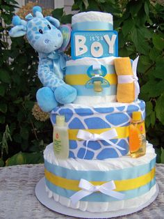 Deluxe Giraffe Baby Diaper Cake! This would double as an amazing centerpiece at the giraffe themed baby shower!