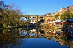 Catch the train from Harrogate and you'll cross this beautiful viaduct into Knaresborough England; a maze of cobbled paths and stone staircases weaving up from the river, all dramatically set into a rocky gorge. #EnglishViews #England #Harrogate #Yorkshire #Knaresborough #KnaresboroughViaduct #Viaduct #Travelgram #Travelpic #Travelinspiration #Instatravel #Traveldeeper