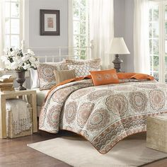 Tangiers instantly adds color and flair to your bedroom. Its bold orange and taupe floral print with large medallions is a modern twist to a classic look. The embroidered detailing on the three decorative pillows pulls the whole look together. This coverlet set also includes two matching standard shams. With a microfiber polyester face and a brushed fabric reverse, this coverlet is soft to the touch and machine washable for easy care.