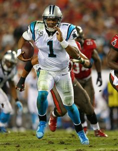 Cam Newton #1 of the Carolina Panthers rushes during a game against the Tampa Bay Buccaneers at Raymond James Stadium on October 24, 2013 in Tampa, Florida.