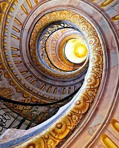 Hand Painted staircase spiraling upwards and looking up to the highest peak.