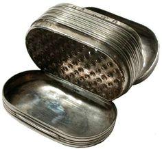 A Georgian silver nutmeg grater of reeded oval form by Matthew Linwood, Birmingham 1804