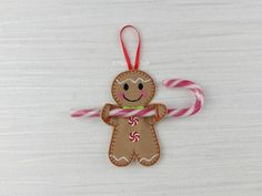 ONE Cute Candy Cane Gingerbread Girl Holder (NO candy cane included) These cute gingerbread man measure 3 in height and come with a red hanging tag so that you can hang them up. Perfect for a little stocking filler or maybe a Christmas tag on that main gift. They come WITHOUT any candy cane. Please take a look at my other Items too https://www.etsy.com/uk/shop/AHeartlyCraft?section_id=15974723&ref=shopsection_leftnav_5 You can also find me on Facebook at A Heartly Craft or Heartly Felt…