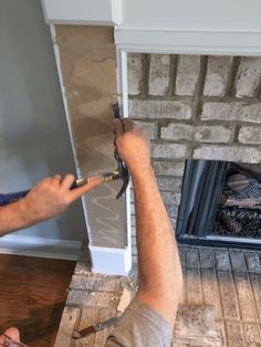 How to Add Herringbone Marble Tile to a Fireplace - Southern Hospitality Removing Fireplace, Tv Over Fireplace, Fireplace Mantle, Fireplace Surrounds, Fireplace Ideas, Natural Stone Fireplaces, Marble Fireplaces, Granite Polish, Marble Tiles