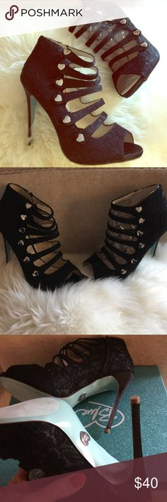 Brand NIB Betsey Johnson Blue Black Lace Heels 9 Brand new in box, Betsey Johnson Blue bridal heels with heart buttons and an open toe. Heels have a lace overlay and blue bottom. Never worn and perfect for any occasion or a bride to be. Size 9, comes with box Betsey Johnson Shoes Heeled Boots