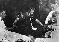 """Mina """"Margery"""" Crandon oozing ectoplasm from her ear during a Boston seance circa 1925."""