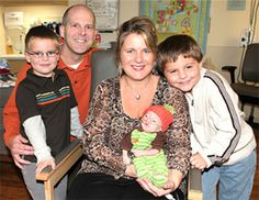 Sheryl Crosier, holding little Simon, with husband Scott, and Simon's brothers Sean (left) and Samuel.