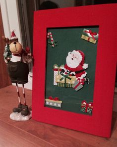 "easy, easy DIY christmas decoration. paint the frame, put stickers on card stock and you have yourself a ""Christmas picture"""
