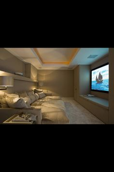 maybe have the TV on the side wall of the bonus room and just buy a big cushy sectional or L shaped sofa