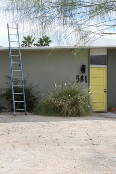 Mid-Century Home in Palm Springs (photo by Marcia Prentice) There's the yellow door again :-)
