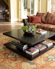 """Book It"" Coffee Table DetailsContemporary and exceptional coffee table has a ""pepper"" finish and a pedestal base to store books and magazines. Made of poplar and birch. 48""Sq. x 20""T. Imported."