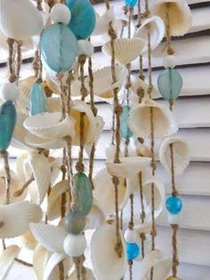Wind chime with shells, blue ceramic balls as summer decoration .- Windspiel mit Muscheln, blaue Keramikkugeln als Sommerdeko wohnideen.minimal… Wind chime with shells, blue ceramic balls as summer decoration wohnideen. Seashell Art, Seashell Crafts, Beach Crafts, Diy And Crafts, Seashell Mobile, Seashell Garland, Cork Crafts, Wooden Crafts, Bottle Crafts