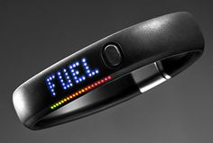 """Nike+ FuelBand on your wrist, and it'll keep track of your activity throughout the day, awarding you """"fuel points"""" that track calories burned, steps and the time."""