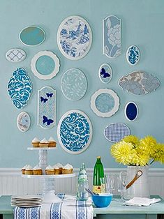 Plates mixed with plaques. Use scrapbook paper to coordinate.