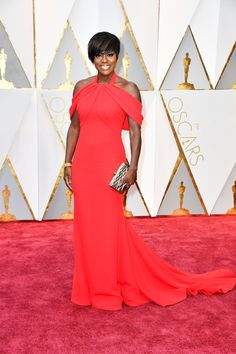 Viola Davis, who won for Best Actress in a Supporting Role for her work in 'Fences,' hit it out of the park with this red-hot, cold shoulder Armani gown.