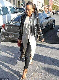 Covered up for court: Karrueche wore a more demure outfit as she arrived at a Washington D.C. court on Monday to support Chris Brown during ...