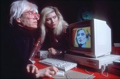Advertising relates new ideas to things we already know.: Andy manipulates Debbie Harry's image using ProPaint on the Amiga 1000