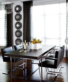 Modern black sheer draperies in a dining room with modern furniture