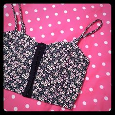 Floral bustier Floral bustier with hook and eye closure. Only tried on, never worn! Perfect condition. Straps are adjustable. Would be super cute for music festivals or layered under a button down! Forever 21 Tops Crop Tops