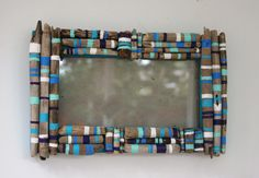i am inspiredby this mirror  to make a wreath with driftwoodmy inspiration --Driftwood Frames with white, purple, aqua, turquoise, sky blue. $45.00, via Etsy.