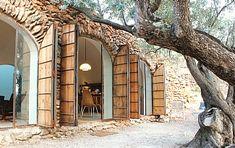 Underground house in Spain with huge storm/shutter doors. Very unique