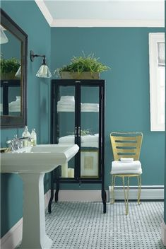Look at the paint color combination I created with Benjamin Moore. Via @benjamin_moore. Wall: Baltic Sea CSP-680; Trim: Decorator's White CC-20; Chair: Brookside Moss 2145-30.