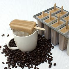Iced Coffee Popsicles;      3 cups fresh brewed coffee      ¾ cup half and half cream (10% cream)      ½ cup sugar