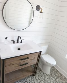 A powder room worthy of the Parade of Homes! Check out our collaboration with DVS Construction at 5545 Stanton Woods Dr. Mannington luxury vinyl in Deco- wrought iron